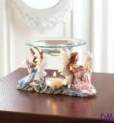 Two Colorful Fairies Holding Dove Oil Warmer