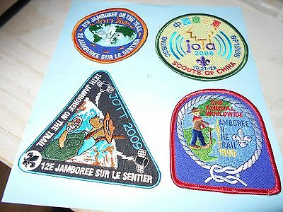 (Mz7-R)  Four Scouts Jamboree On The Trail Badges