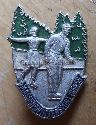 m72) c1954 East German winter sports event tinnie skating skiing badge DDR GDR