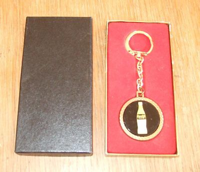 1970s Coca-Cola key ring~gold bottle on black background~MIB