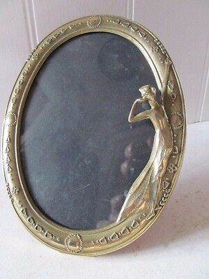 A Solid Brass Art Nouveau Oval Photo Frame.