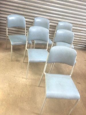 6 tubular metal Cox style blue leatherette stacking chairs function cafe or home