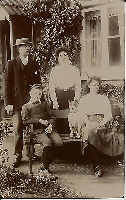 Smooth Haired Terrier & Family Real Photographic Dog Postcard
