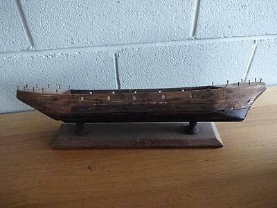 An Antique Wooden Hand Made Scratch Built Boat Hull On Stand Leaning To 1 Side
