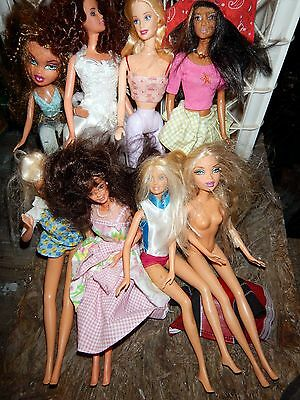 Lot of eight (8) Dolls Clothed & Nude Barbie & Misc.