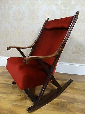stunning antique edwardian x framed rocking armchair with opulent red velvet