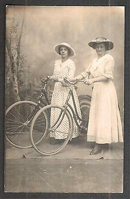 2 women with bicycles, old photo postcard