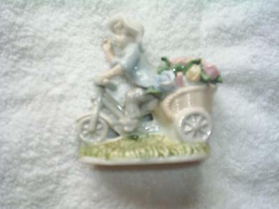 "Little boy on bike approx..  4""  x   4"" -  excellent condition"