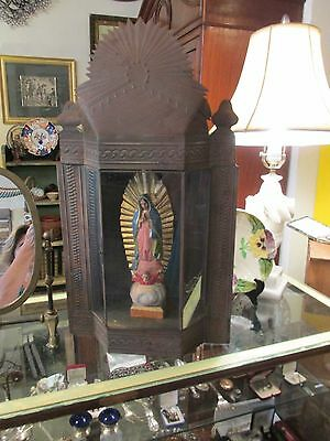 Large Mexican tin nicho with carved wood santos guadalupe