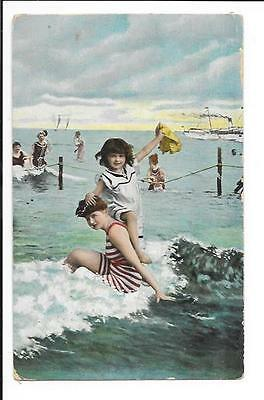 Old postcard: Norfolk: Great Yarmouth? Playing in the sea.