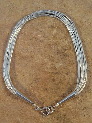 Beautiful 10 Strand Liquid Silver Bracelet 4.2 grams