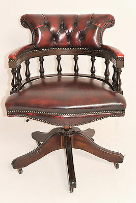 A 20th Century Red Leather Captains Office Chair