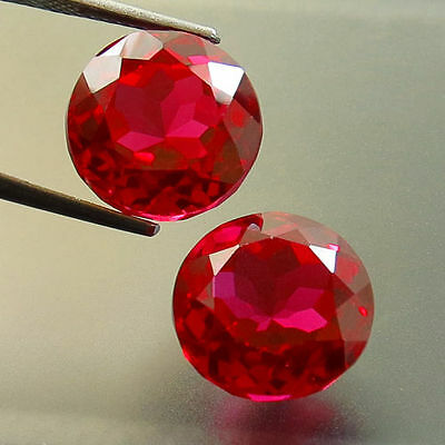 A PAIR OF 8mm ROUND-FACET TOP-RED LAB RUBY GEMSTONES