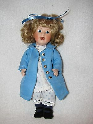 "Sweet 8"" All Bisque Doll Wearing Blue Coat"