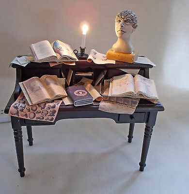 Dolls house miniature Table of books and scrolls about Phrenology (head bumps!)