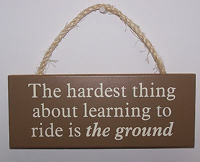 """""""THE HARDEST THING ABOUT LEARNING TO RIDE IS THE GROUND"""" Wood Sign Made In USA"""