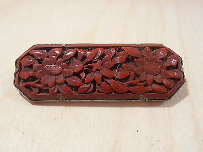 A vintage chinese cinnabar and white metal pin brooch