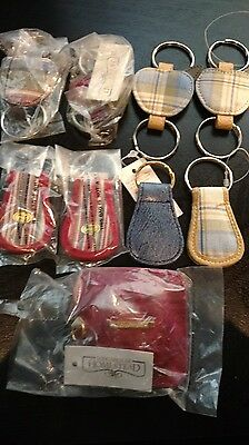 Longaberger set of EIGHT keychains and a Purse Measuring tape, all mint not used