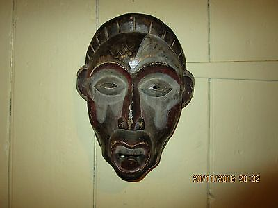 Antique carved Wood African Tribal mask / African Ceremonial mask .Grey /Red