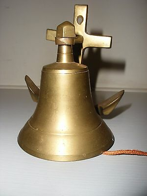 "Wall Mounted Brass Bell With A Nautical Theme 4"" Tall"