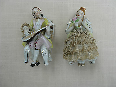 A Pair of Continental seated figures.