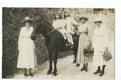 Herefordshire RP of 3 ladies with three children on a pony at Linton