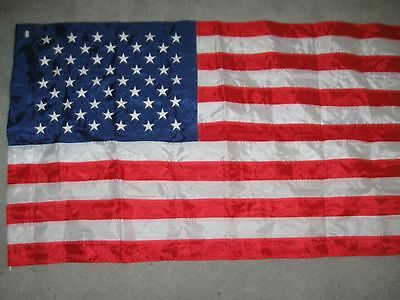 "AMERICAN FLAG no gromets Has sleeve to fit over pole Nylon 49""X28"" Stars emboid."