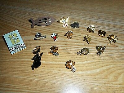 Set of 16 assorted pins for tie, hat, or shirt.