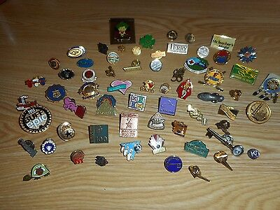 Set of over 60 assorted pins for tie, hat, or shirt.