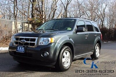 2009 Ford Escape XLT 4WD MOON ROOF,RUNNING BOARDS,CLEAN CAR FAX. LOW RESERVE,ONE OWNER,GREAT LOOK INSIDE & OUT