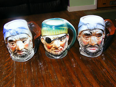 Three Japanese Miniature Character Jugs. 3 Inches Tall