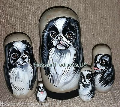 Japanese Chin on Five Russian Nesting Dolls. Dogs.