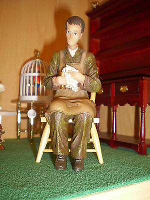 Dolls house figure, 1/12th scale poly/resin Man sitting cleaning glass DP309