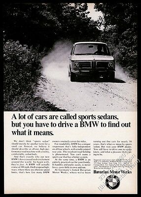 1969 BMW 2002 car on dirt road photo vintage print ad
