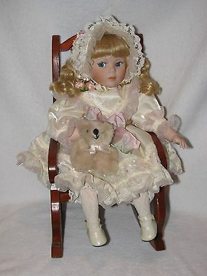 Pretty Porcelain Little Girl Doll Dressed Beautifully Sitting In Rocking Chair