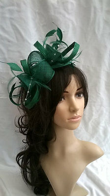 Emerald Green Feather Fascinator.rosette on a headband..for wedding races..new