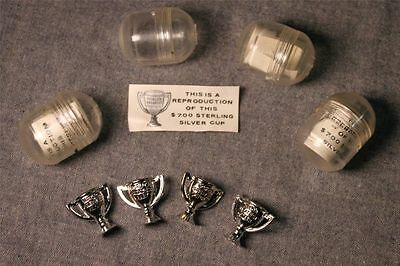"""4 Vintage Miniature """"World's Greatest"""" Trophy Capsuled Gumball Prizes"""
