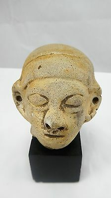 Pre columbian pottery head on stand.