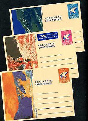 3 old, perfect, unused postcards and mint-hinged stamps on part album pages.