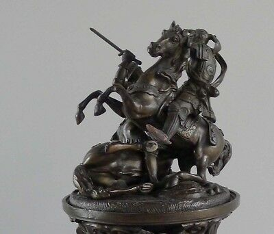 A patinated bronze figural inkwell with Knights fighting on horses English