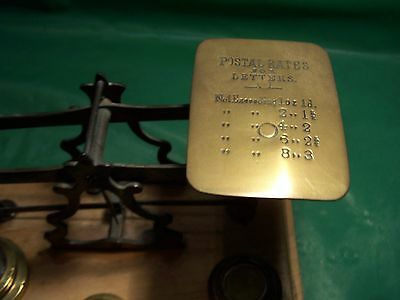 ANTIQUE BRASS POSTAL SCALES with eight brass weights