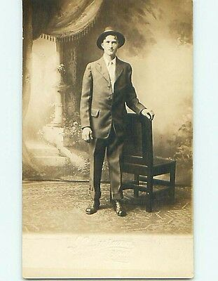 Pre-1918 rppc MAN & ANTIQUE CHAIR EMBOSSED BY STUDIO St. Saint Louis MO t2389