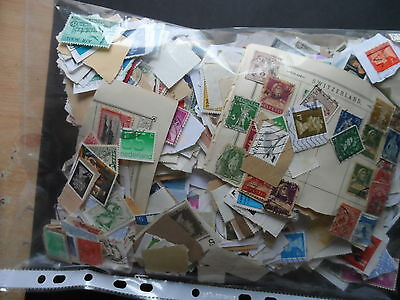 lot 5  300 grms approx G.B & world mix stamps on & off paper pot luck
