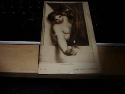 a  nearly nude  french  vintage postcard and holding a rose