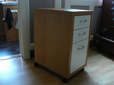 Ikea 3 drawer filing cabinet on small wheels..