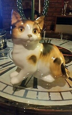 Porcelain cat figurine. Hand painted Staffordshire  made Cat.