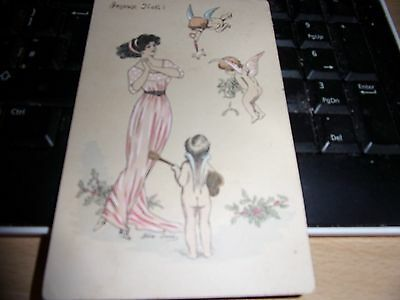 vintage fairy postcard  showing a young woman and  fairies/cupids