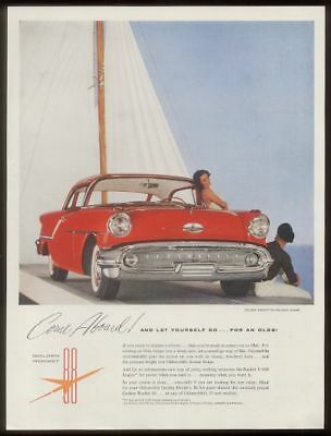 1957 Oldsmobile 88 Holiday Coupe red car photo vintage print ad