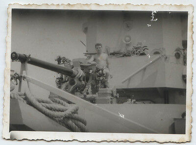 Greece Crew Member Of War Ship On Board Behind A Gun. 1959
