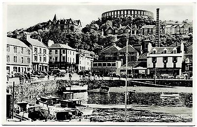 VINTAGE REAL PHOTO POSTCARD . HARBOUR & McCRAIGS TOWER . OBAN. SCOTLAND. P/U1950